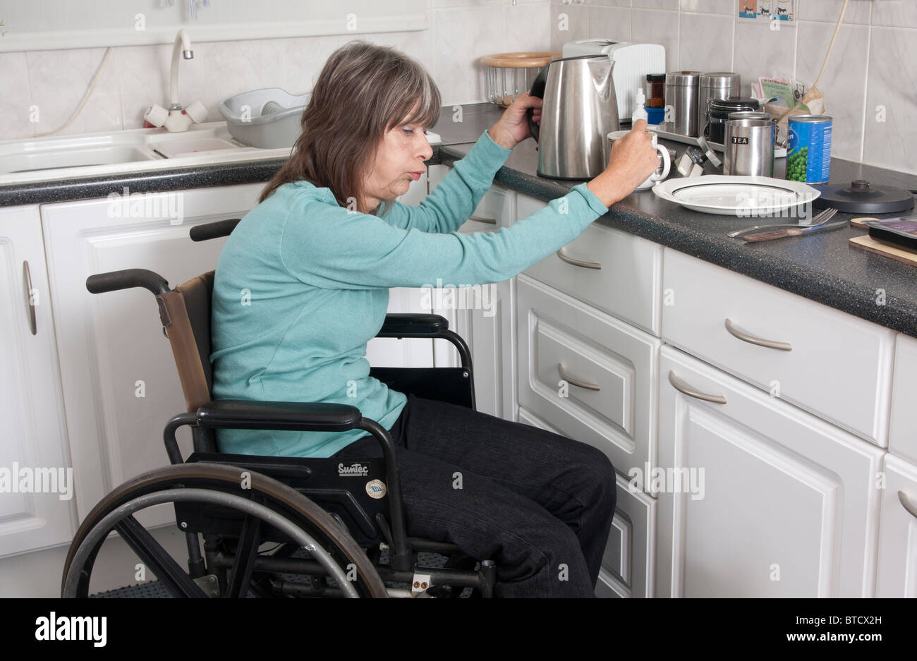 Disabled Woman Cooking Stock Photos & Disabled Woman Cooking Stock ...