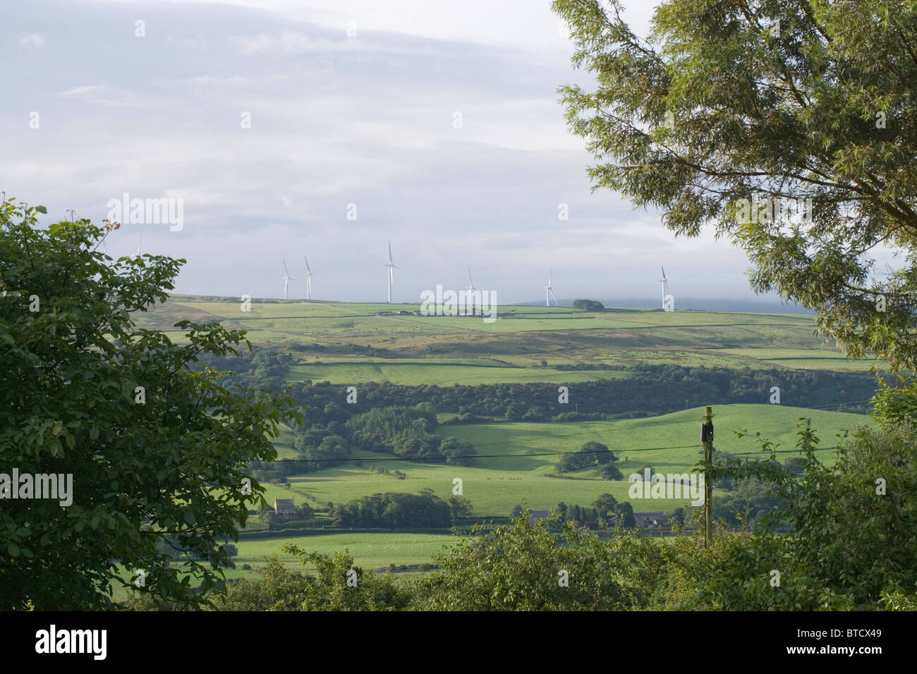 Wind Turbines on Caton Moor, Lancashire. View from Aughton village. - Stock Image