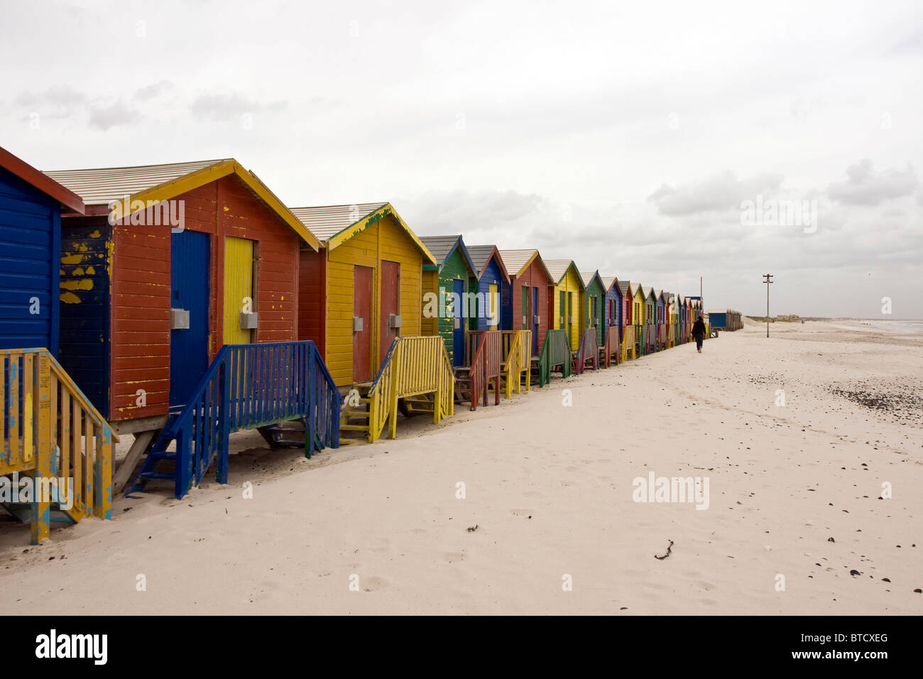 Multi coloured beach huts in Muizenberg, Cape Town, on False Bay coast, South Africa - Stock Image
