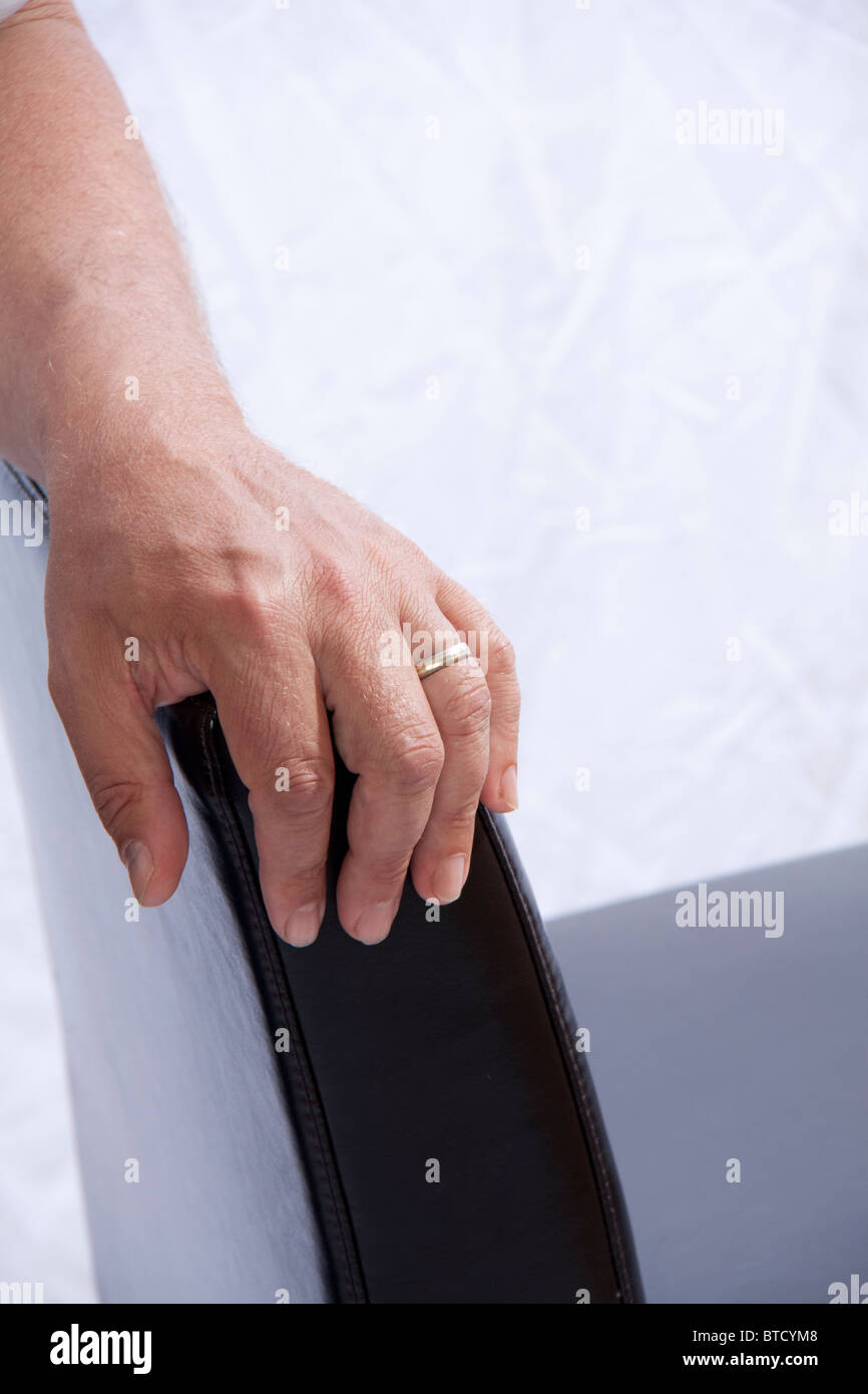 Close up of man's hand with wedding ring - Stock Image