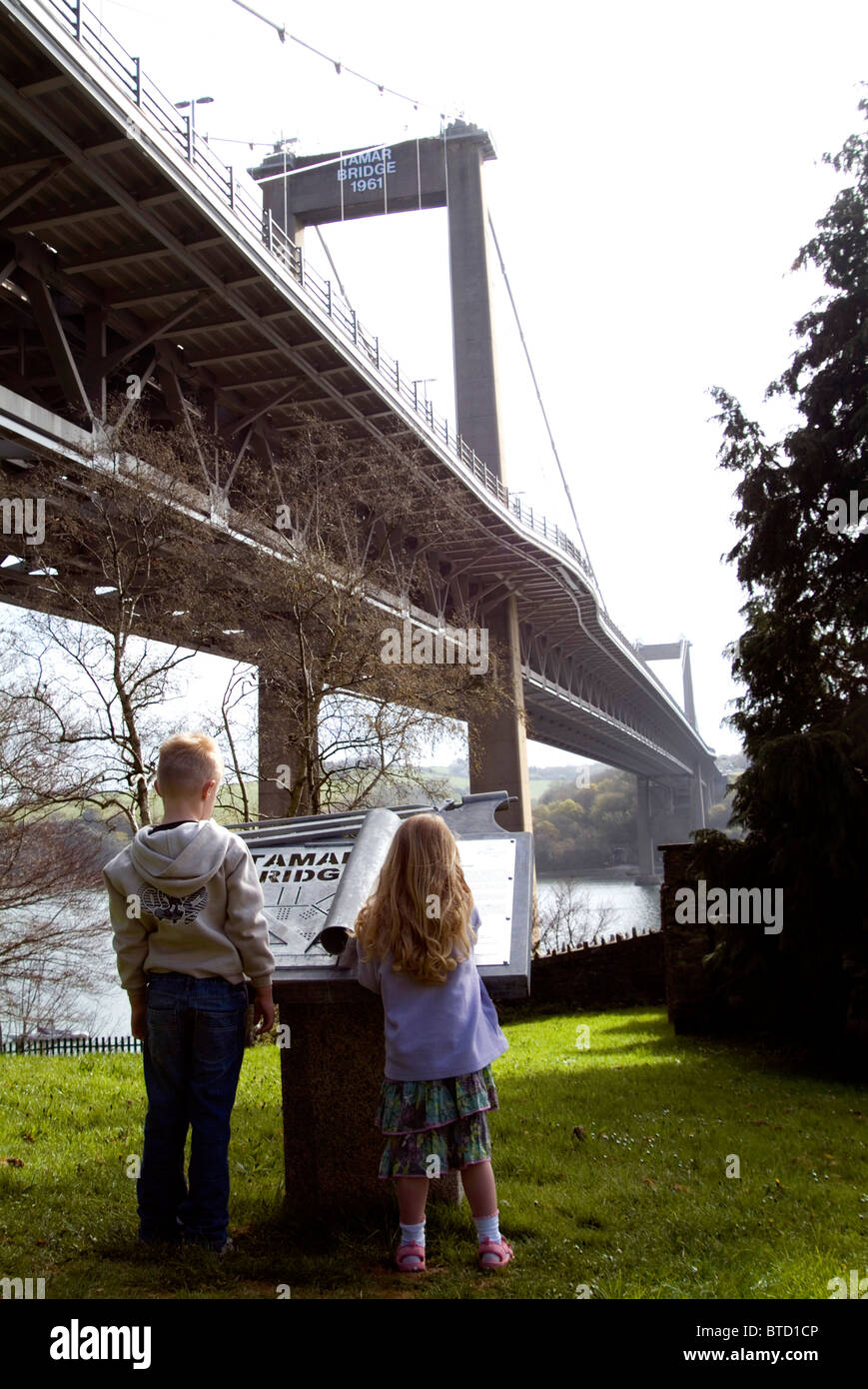 two children looking at sign for tamar bridge - Stock Image