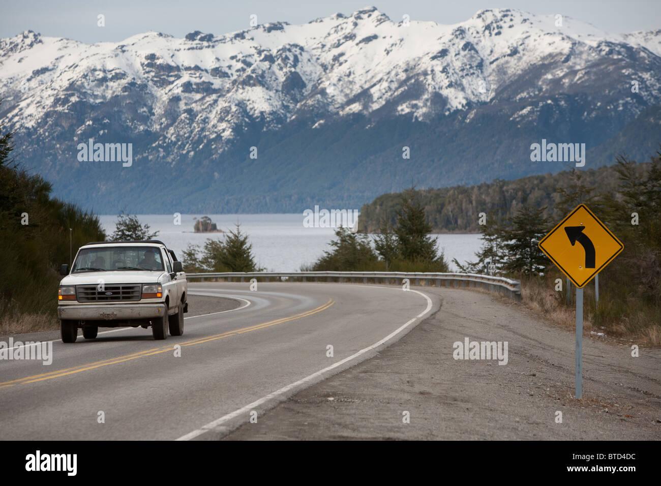 Road to Villa La Angostura with Lake Nahuel Huapi and snowed Andes mountains at the back - Stock Image