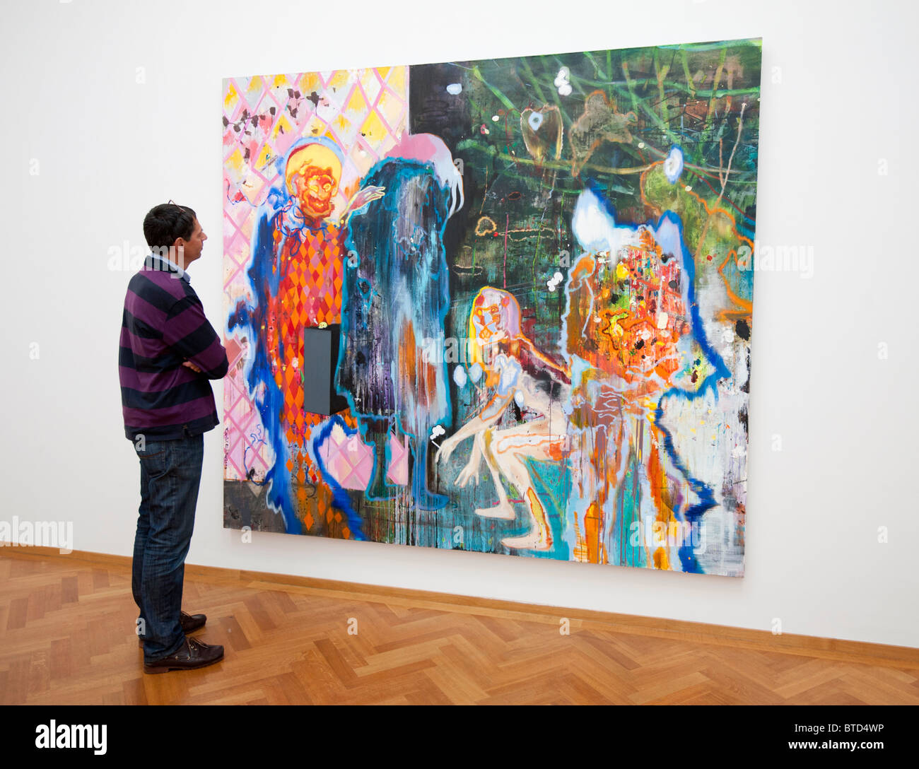 Man looking at painting Uwe, Take the Long and Winding Road by Daniel Richter, at the Gemeentemuseum in The Hague - Stock Image