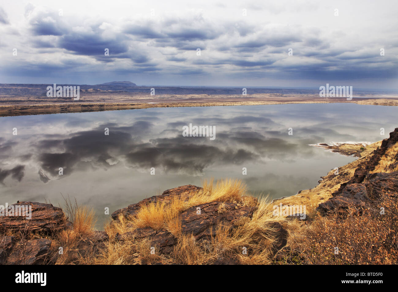 View of Lake Magadi with clouds reflected in its still waters. Rift valley. Kenya Stock Photo