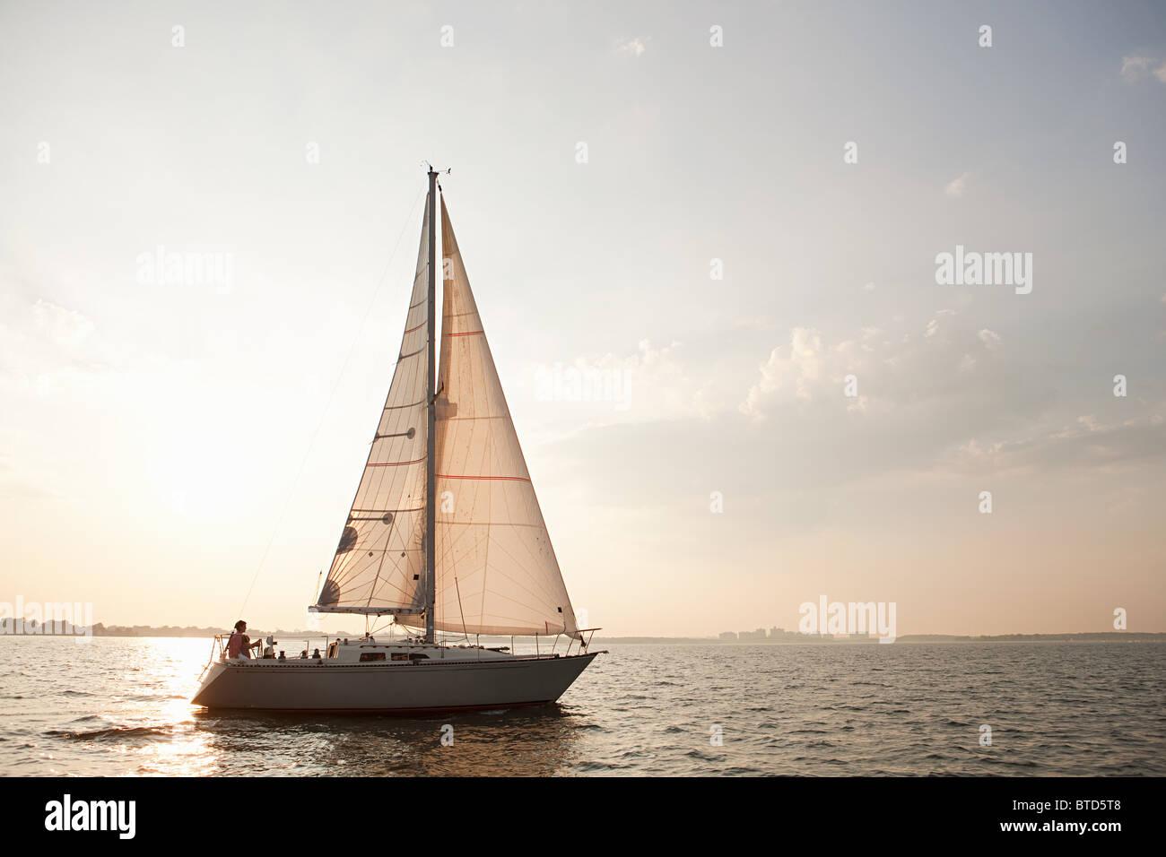 Yacht sailing on sea - Stock Image