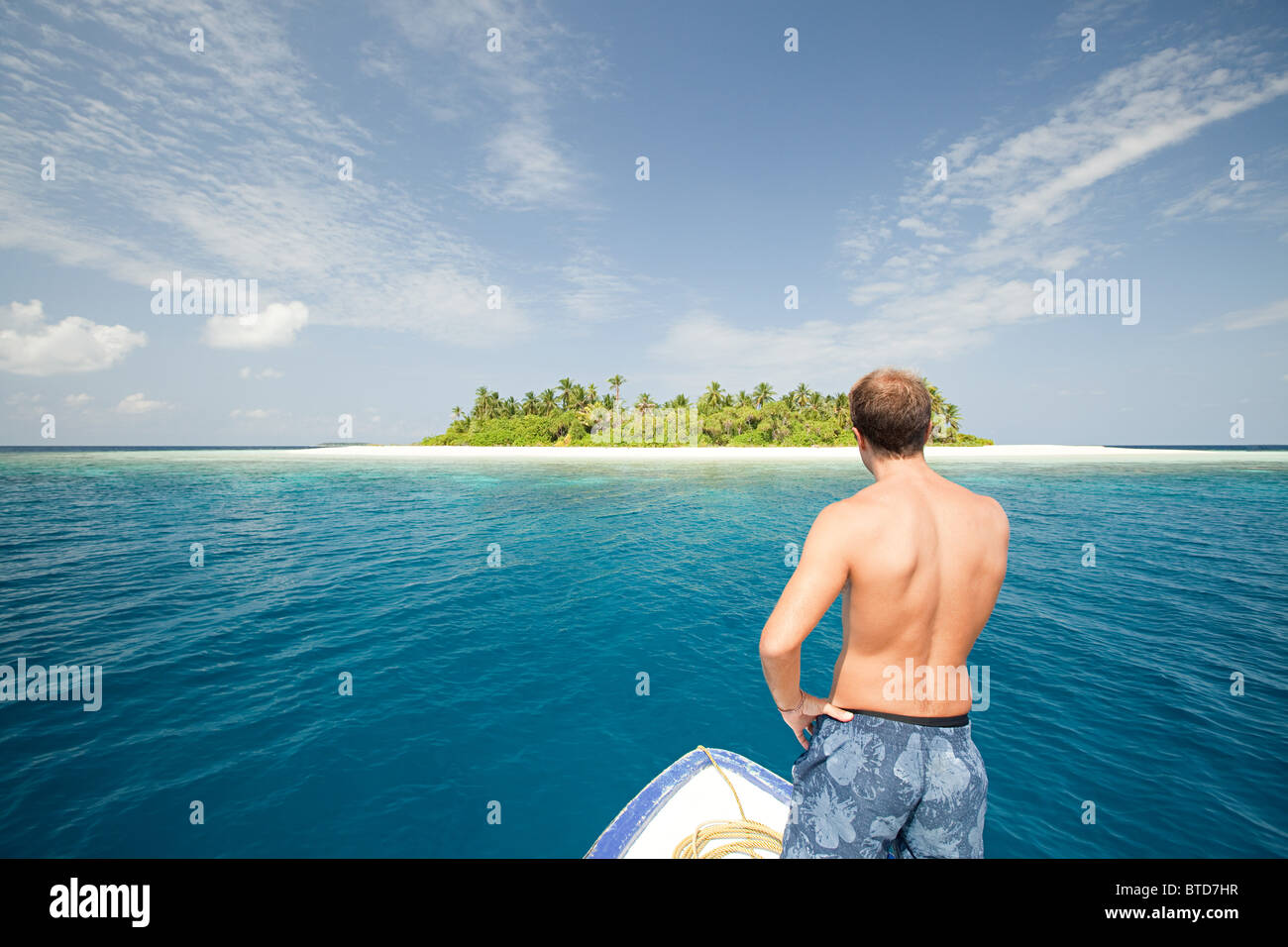 Man with boat, Baughagello Island, South Huvadhu Atoll, Maldives - Stock Image