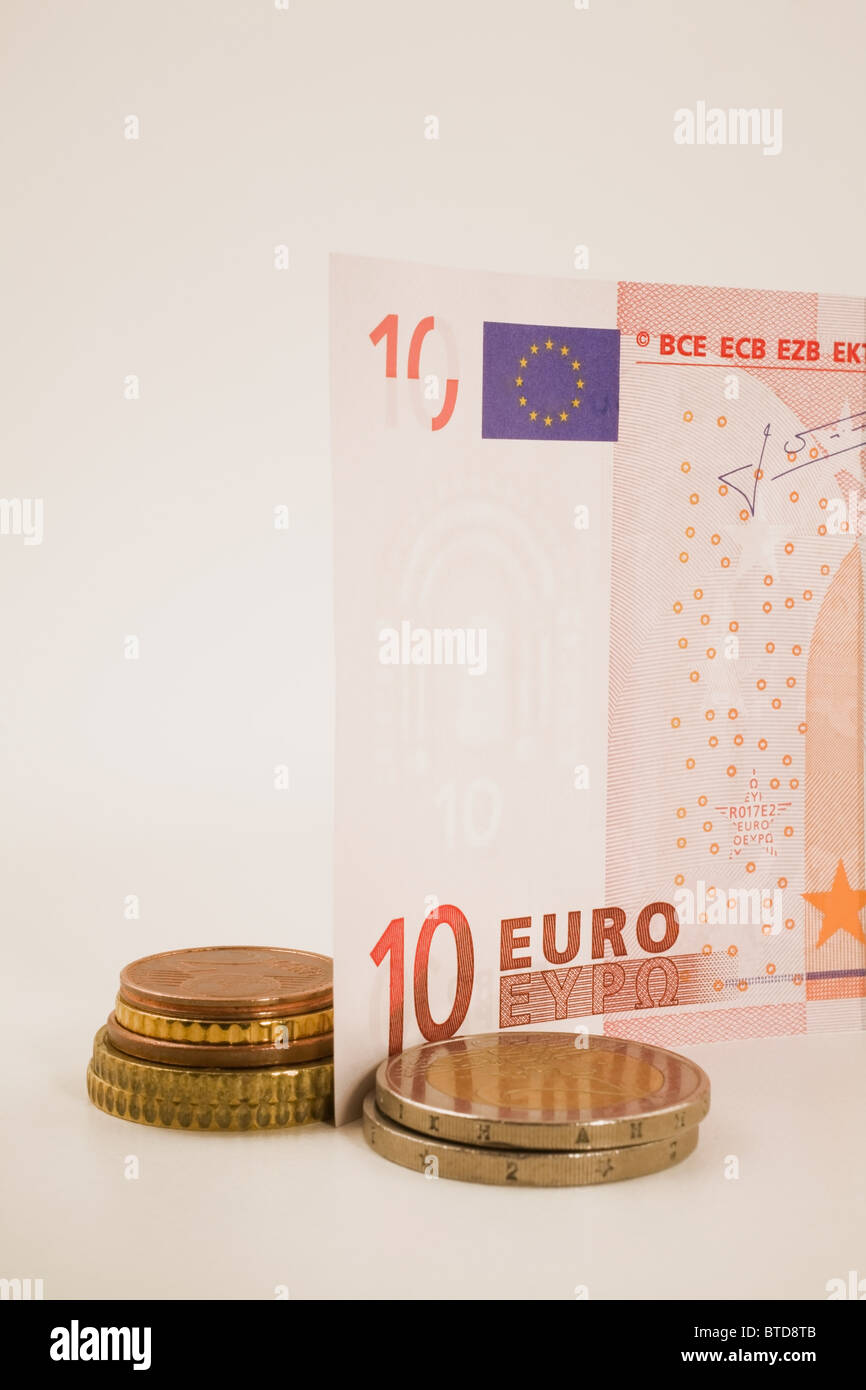 Ten euro note and coins - Stock Image