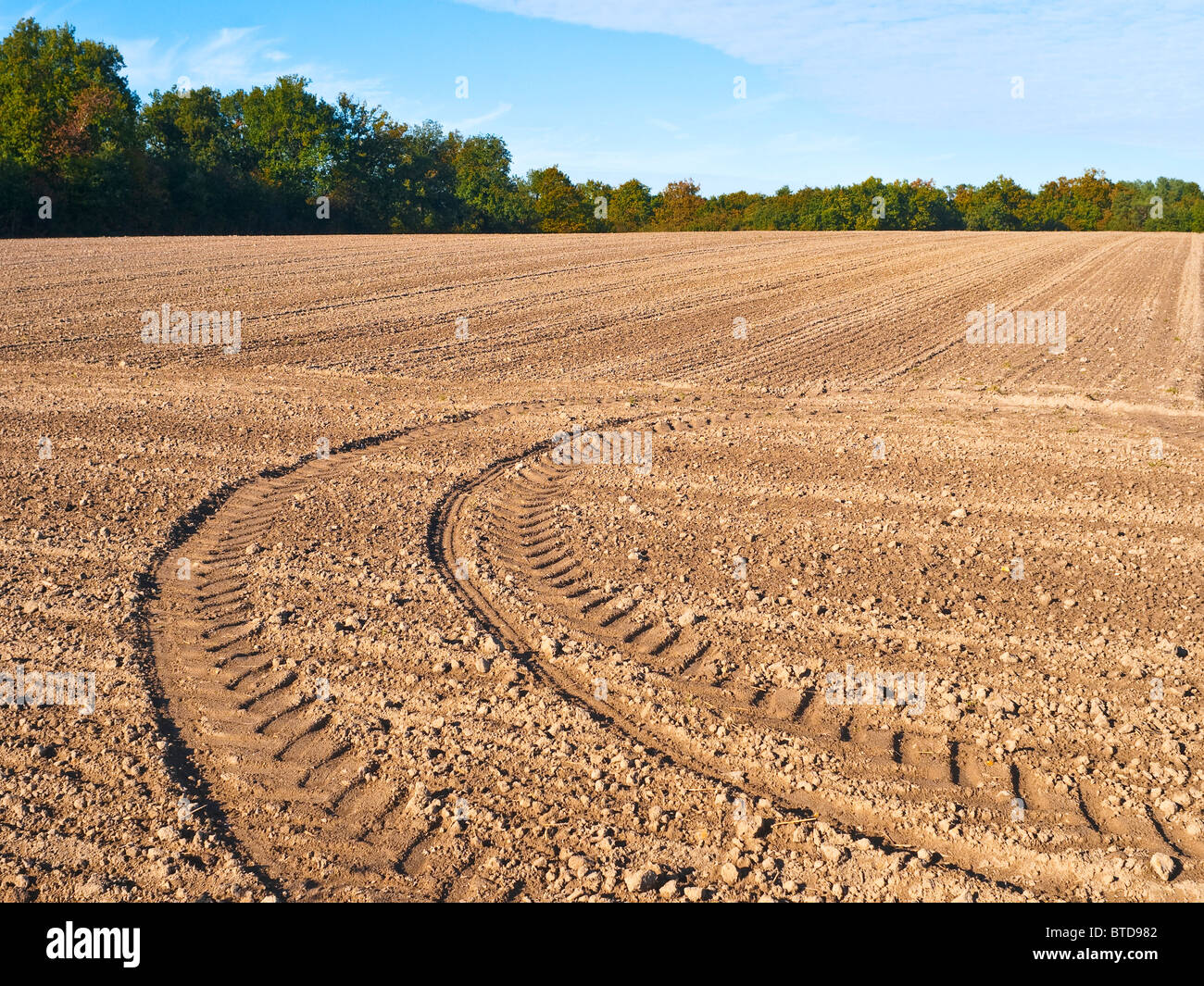 Tractor tyre tracks in farm field - France. - Stock Image