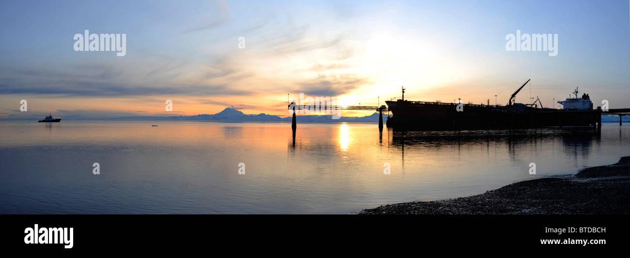 Sunset view of a Russian oil tanker off loading oil at the Kenai Tesoro refinery Kenai Peninsula, Alaska - Stock Image