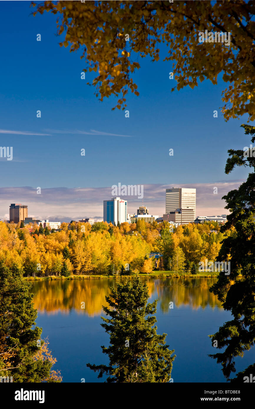 View of downtown Anchorage and Westchester Lagoon on a sunny day in Southcentral Alaska - Stock Image
