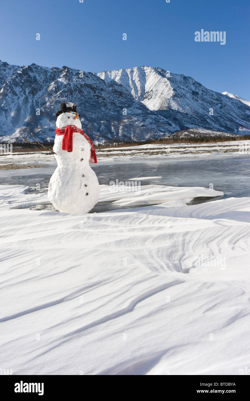 Snowman with Mount McKinley in the background at sunrise, Denali State Park, Alaska, Winter - Stock Image