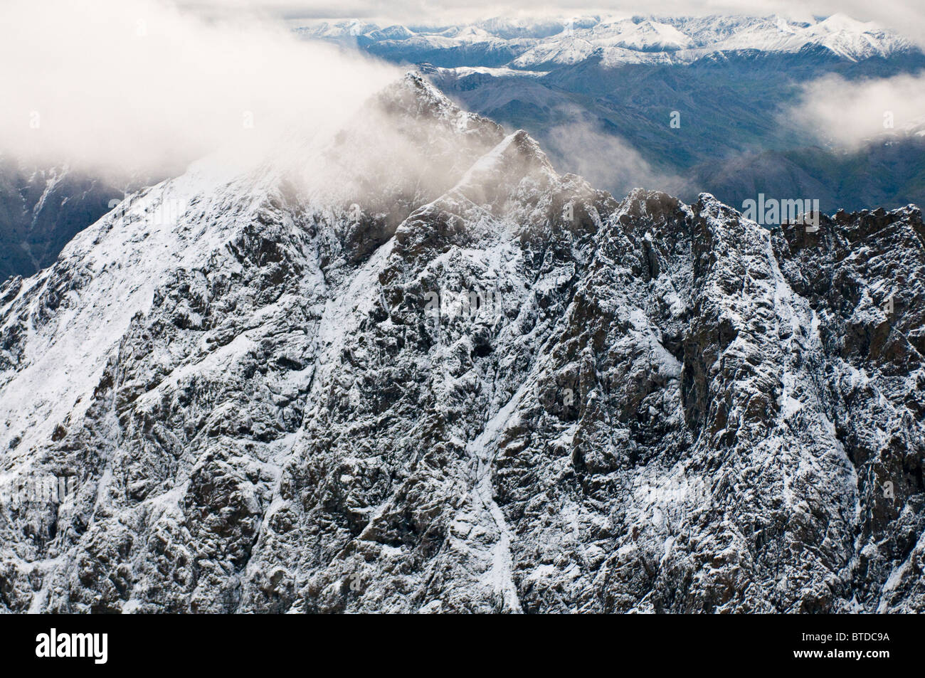 Aerial view of Boreal Mountain summit dusted with fresh snow in Gates of the Arctic National Park and Preserve, - Stock Image
