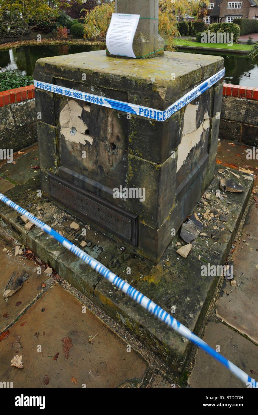 Damaged war memorial, with it s Commemorative brass plaques honouring war heroes stolen. - Stock Image