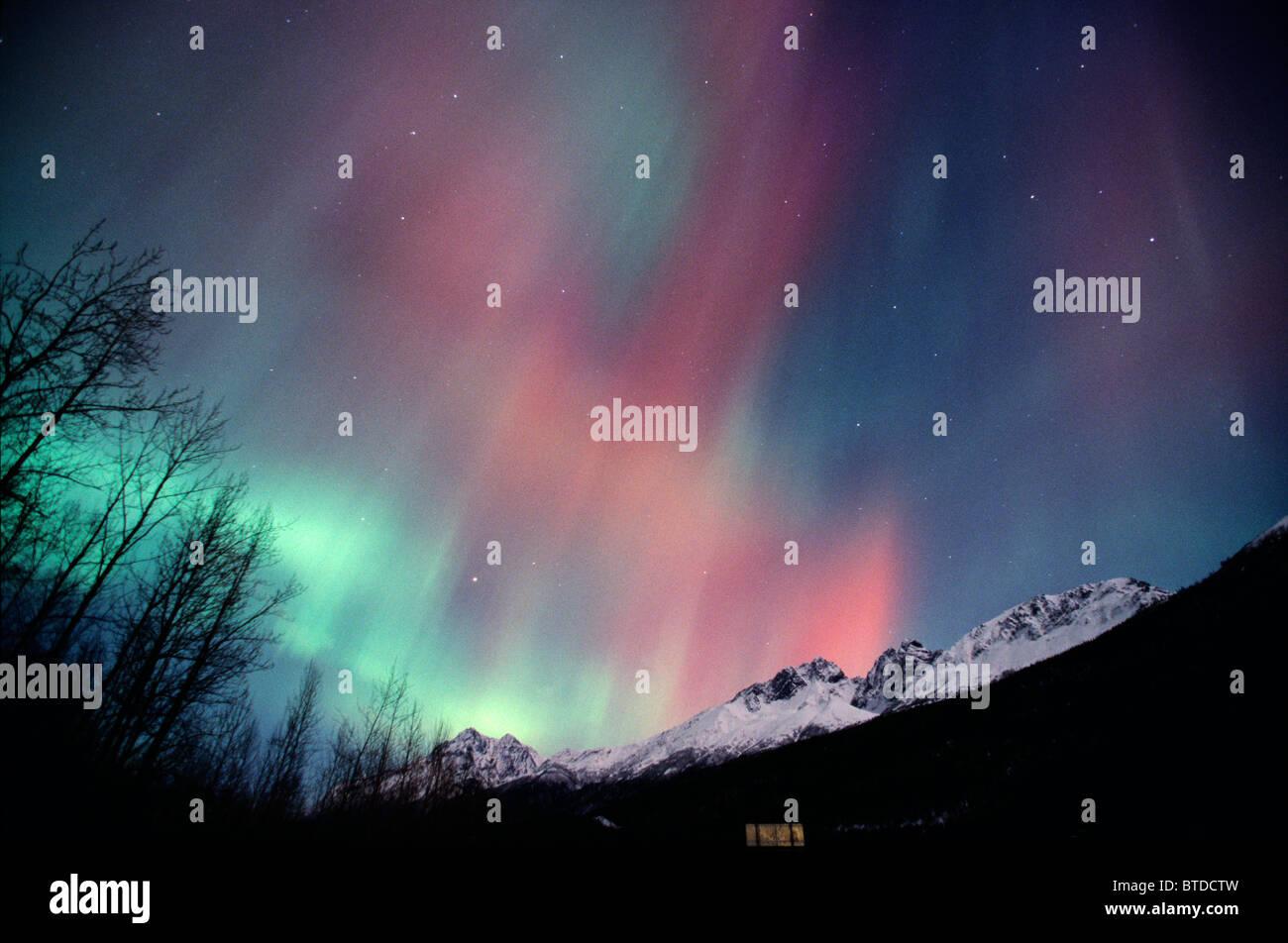 Multi colored Northern Lights (Aurora borealis) fill the night sky off the Old Glen Highway near Palmer, Alaska, - Stock Image