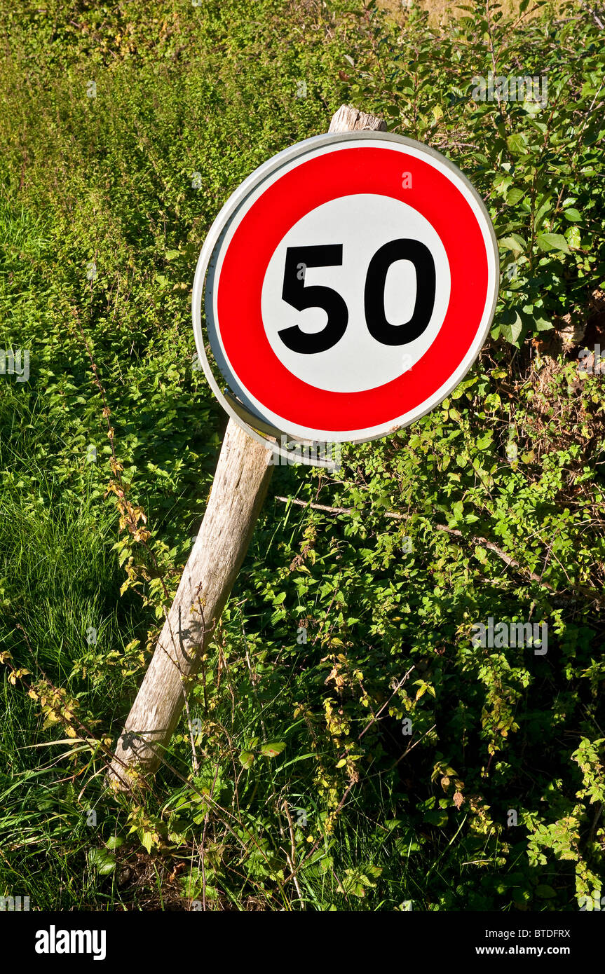 Modern road traffic sign indicating 50 kph speed limit - Indre-et-Loire, France. Stock Photo