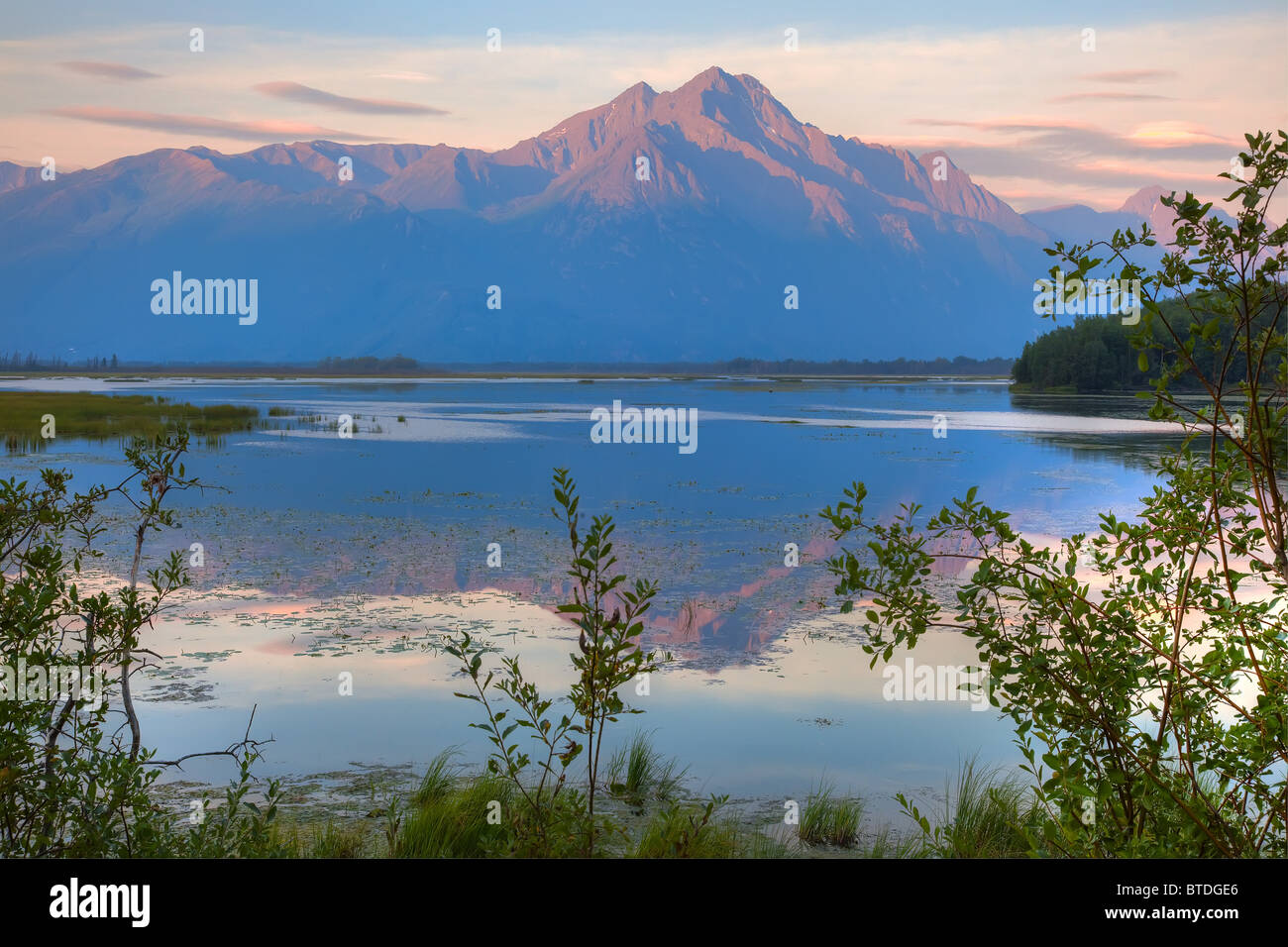 Sunrise on Pioneer Peak with Jim Lake in the foreground, Southcentral Alaska, HDR image - Stock Image