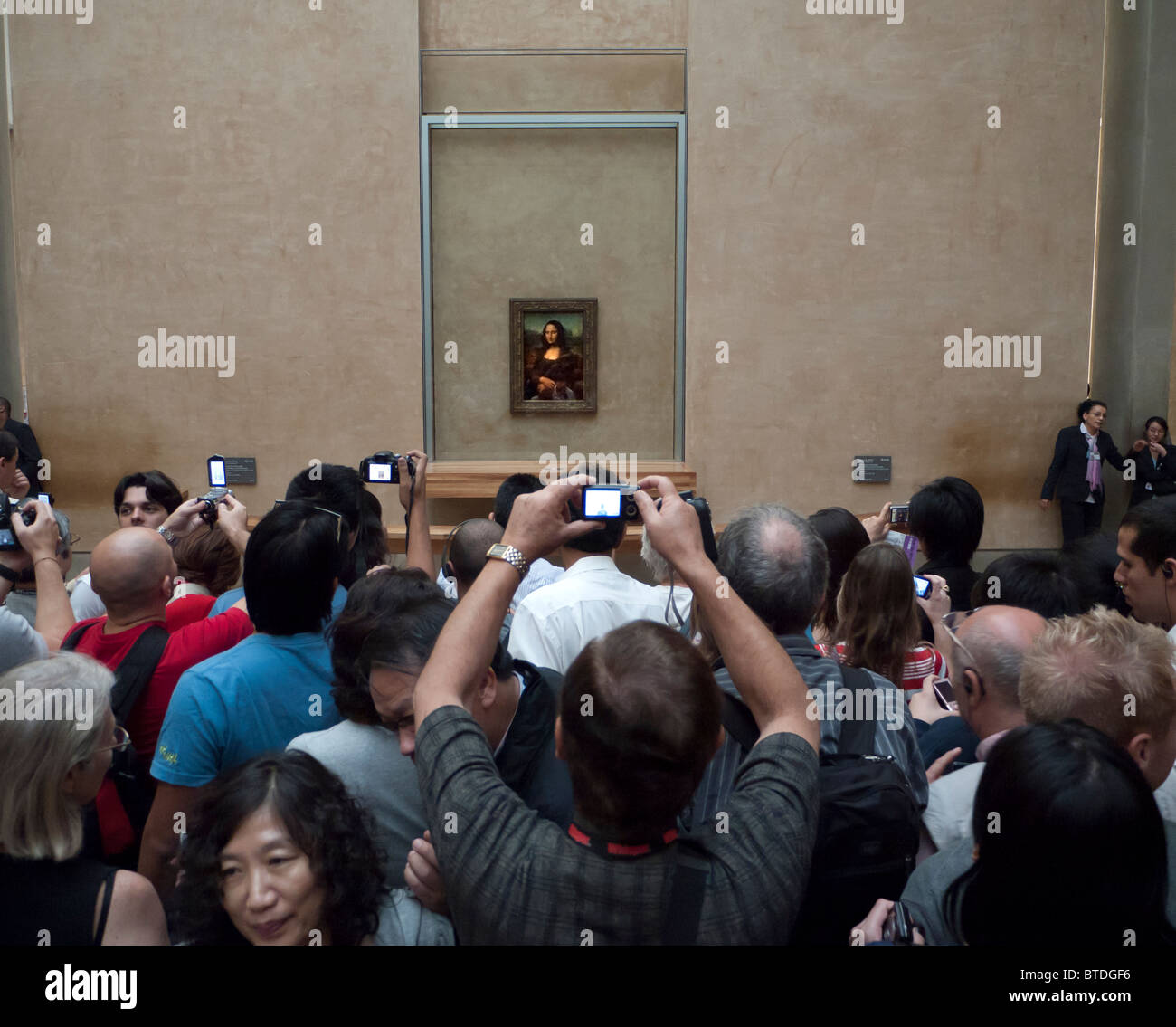Many tourists crowding to see the famous Mona Lisa painting at the Louvre in Paris France - Stock Image