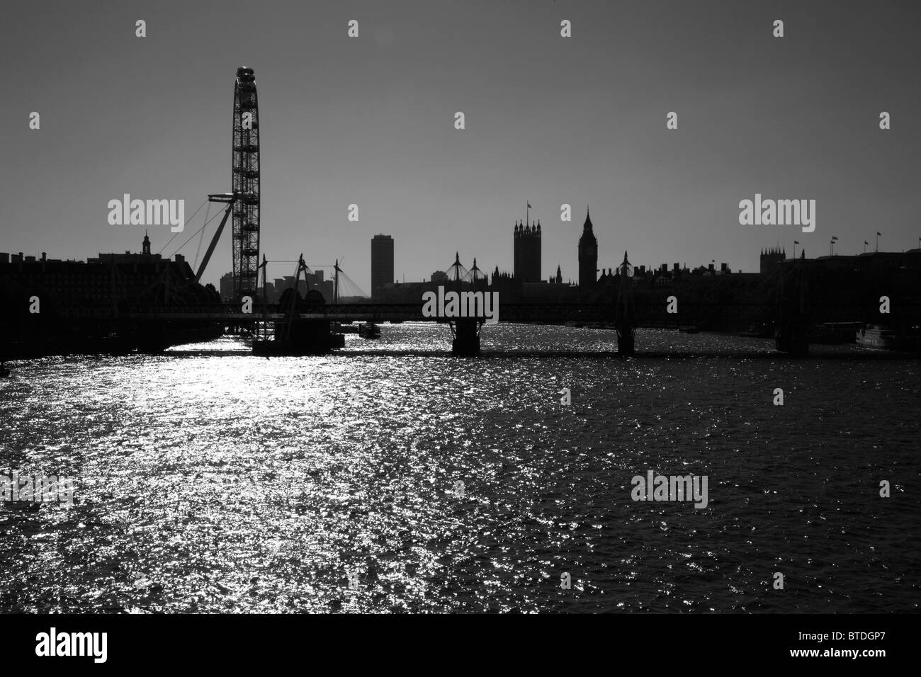 View up the River Thames to Hungerford Bridge, London Eye and Houses of Parliament, Westminster, London, UK - Stock Image