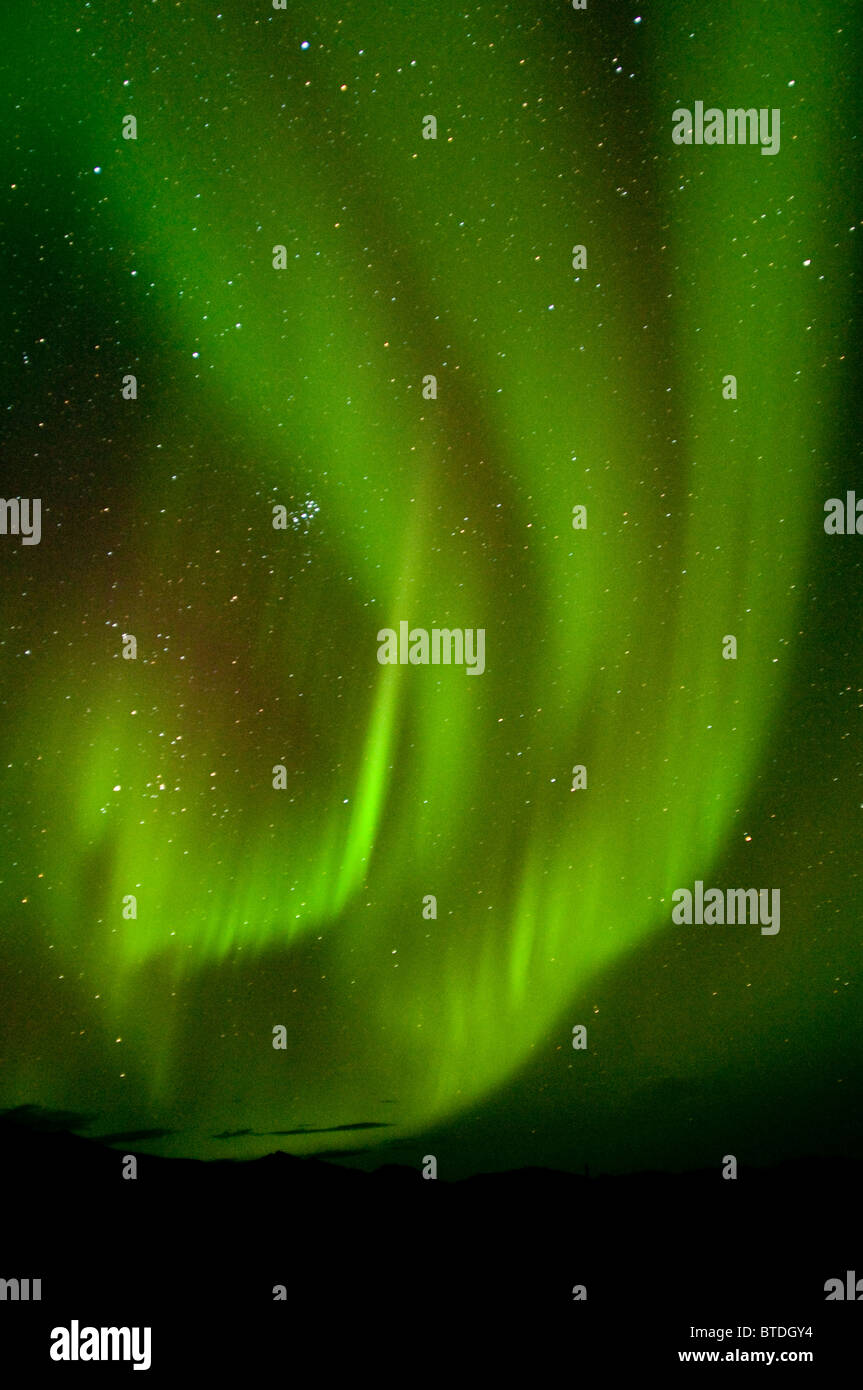 View of Aurora Borealis dancing above Noatak River in Gates of the Arctic National Park and Preserve, Arctic Alaska, - Stock Image