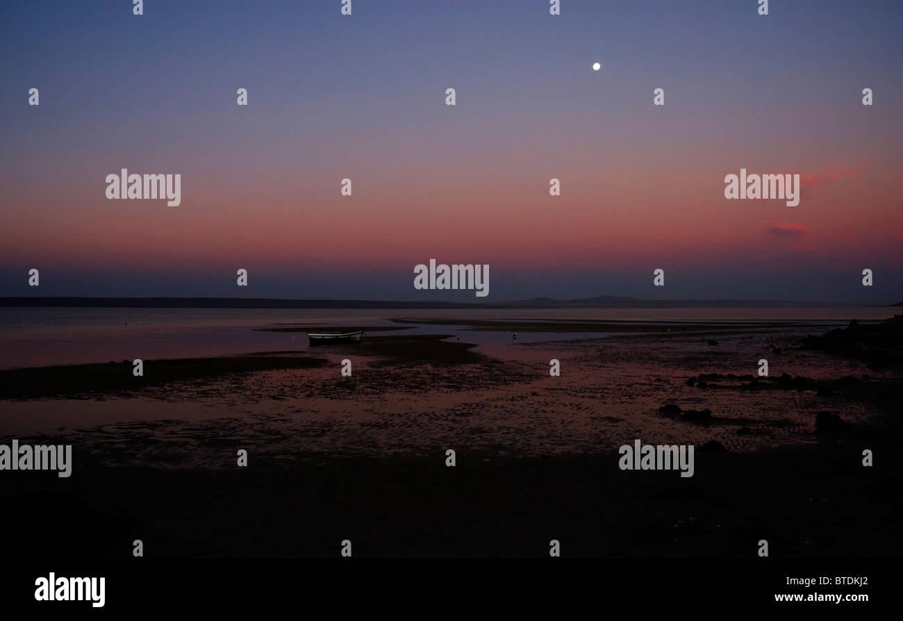 Churchaven lagoon at sunset with the full moon - Stock Image