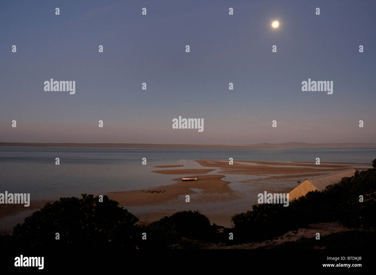 Sunset over the lagoon at Churchaven with full moon - Stock Image