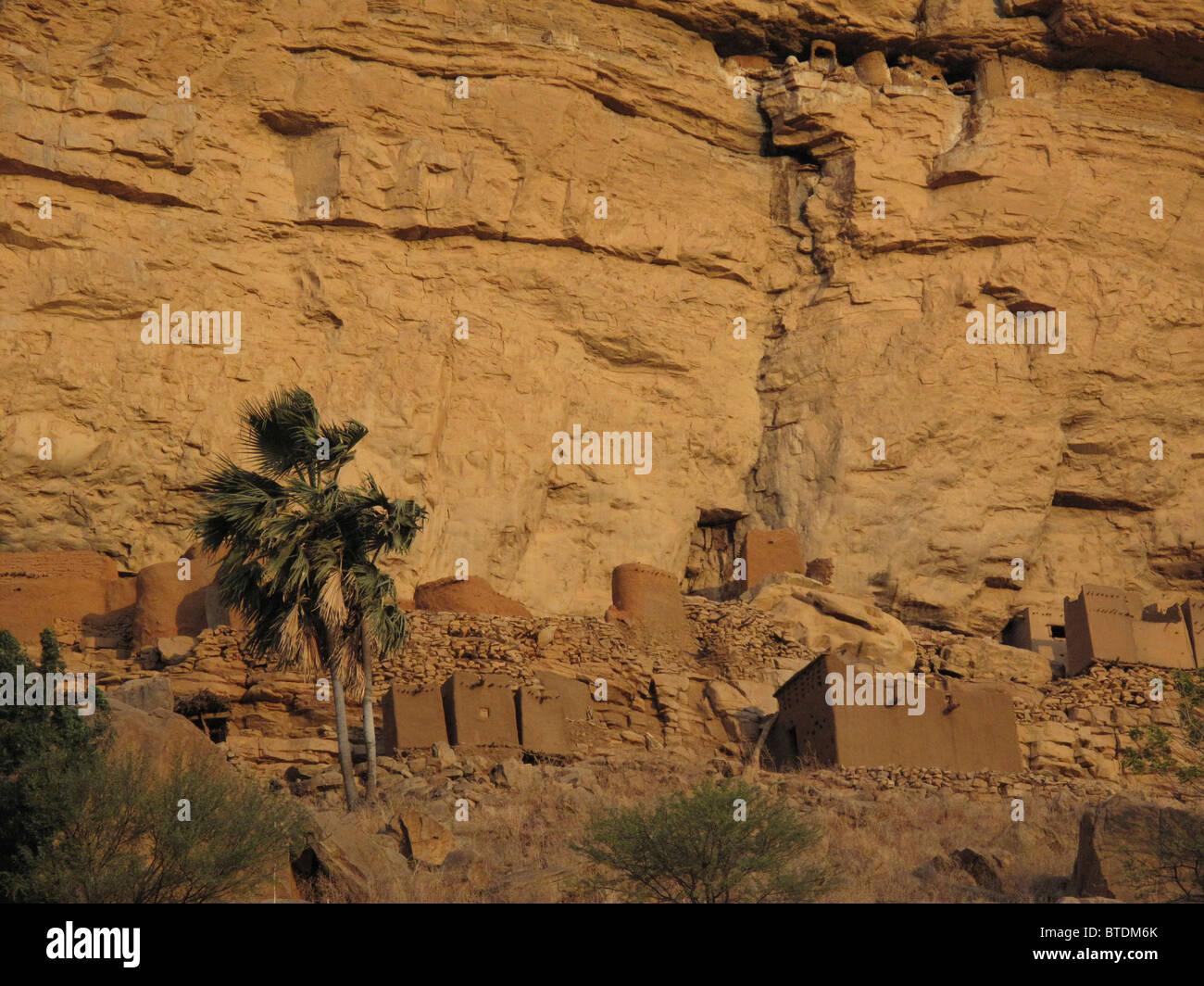 Cliff dwellings along the base of the Bandiagara escarpment Stock Photo