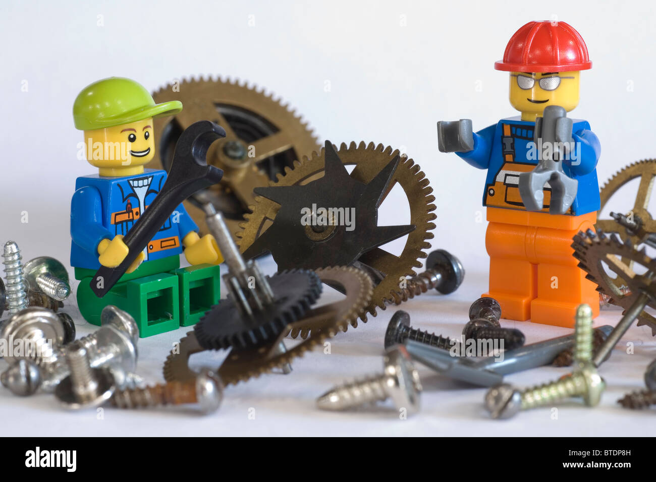 Lego engineers working with machinery components Stock Photo
