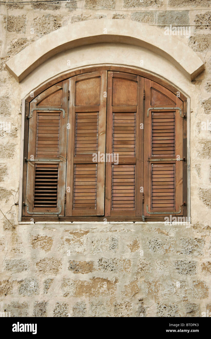 arched window shutters window covering wooden window shutters on an arched stock photo 32265271 alamy