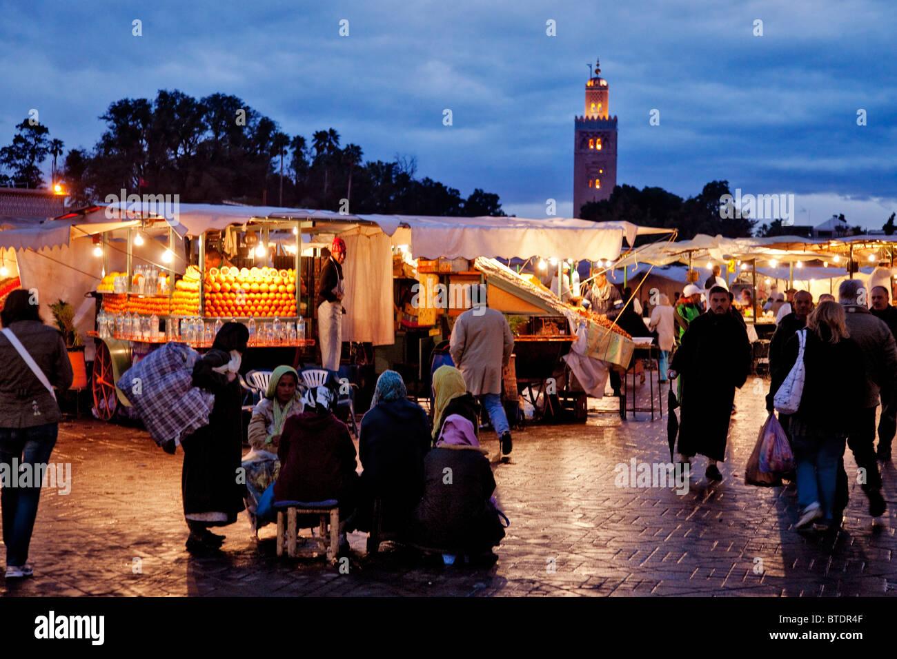 Evening festivities at Marrakech Market or Medina Square - Stock Image