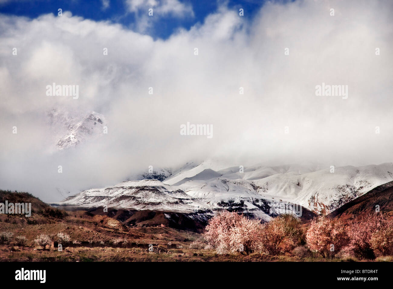 Cloud cover over the snow-covered peaks of the High Atlas mountain - Stock Image