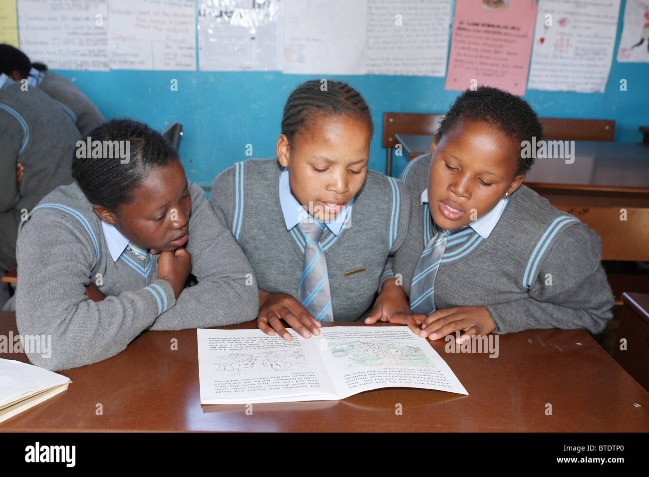 Three high school girls studying together in a classroom in a rural Kwazulu Natal school - Stock Image