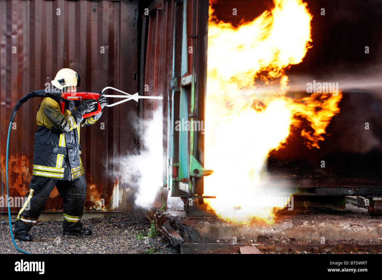 Fire fighting system Cobra. High pressure water jet extinguisher, cuts through metal an other materials to spray - Stock Image