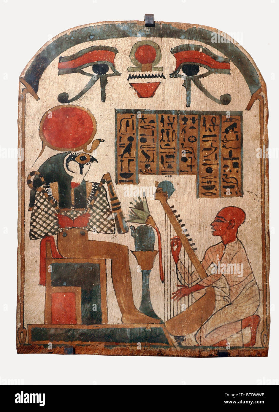 5343. Harp player worshiping the god Horus, the ancient Egyptian god of the sun, son of Osiris and Isis, represented - Stock Image