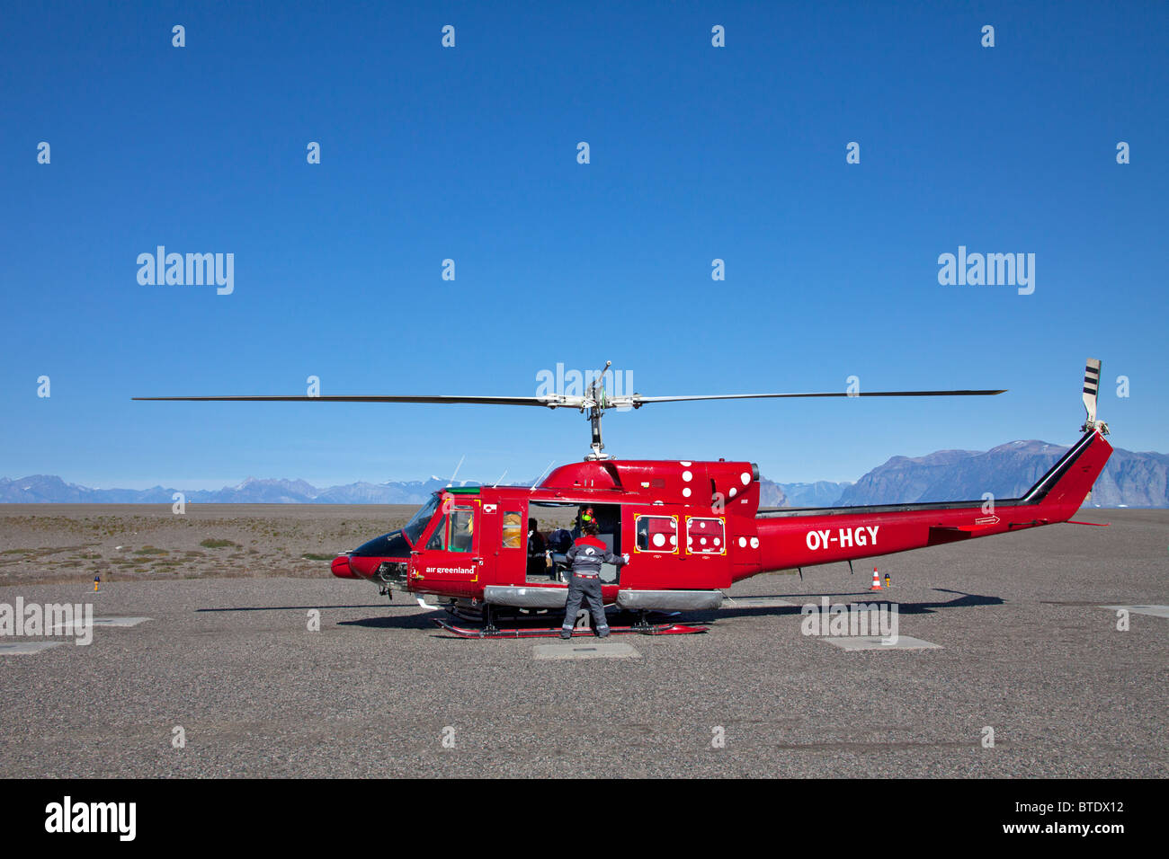 Bell 212 Twin Huey helicopter of Air Greenland at Qaarsut Airport, Greenland - Stock Image