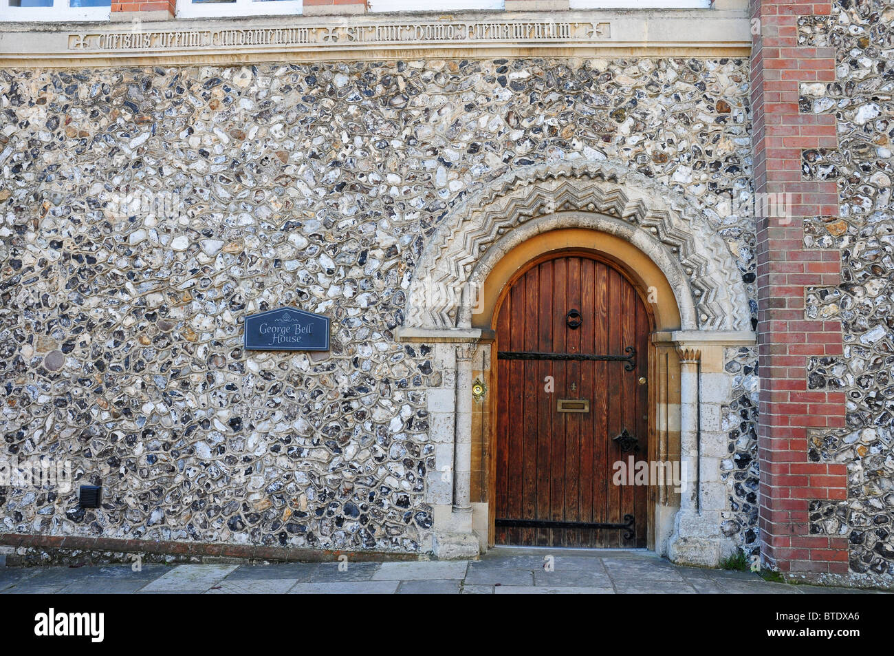 Norman doorway to George Bell House. Canon Lane Chichester. - Stock Image