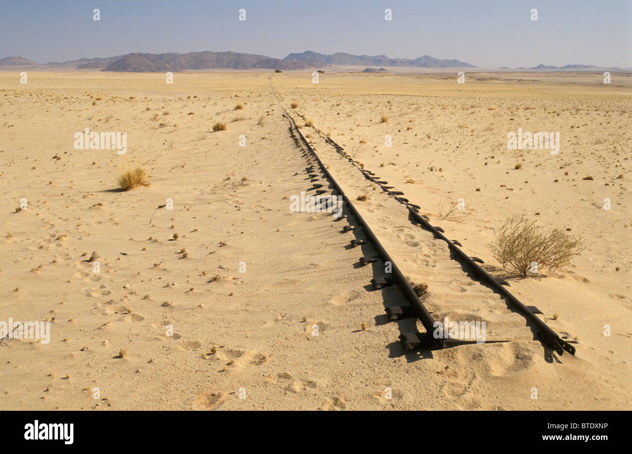 Old railway tracks ending in the middle of nowhere in the desert - Stock Image