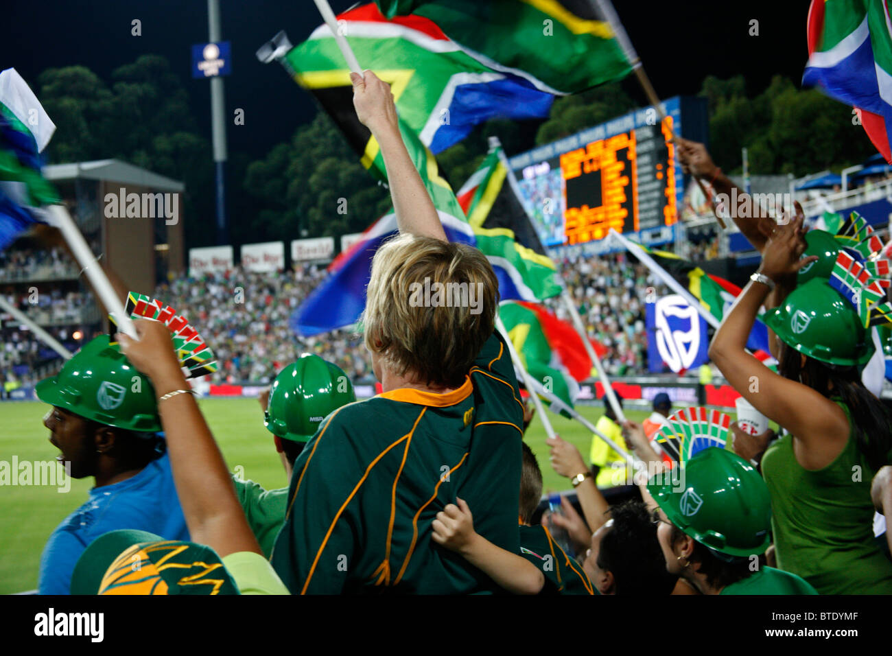 Cricket fans at a Pro20 international cricket match - Stock Image