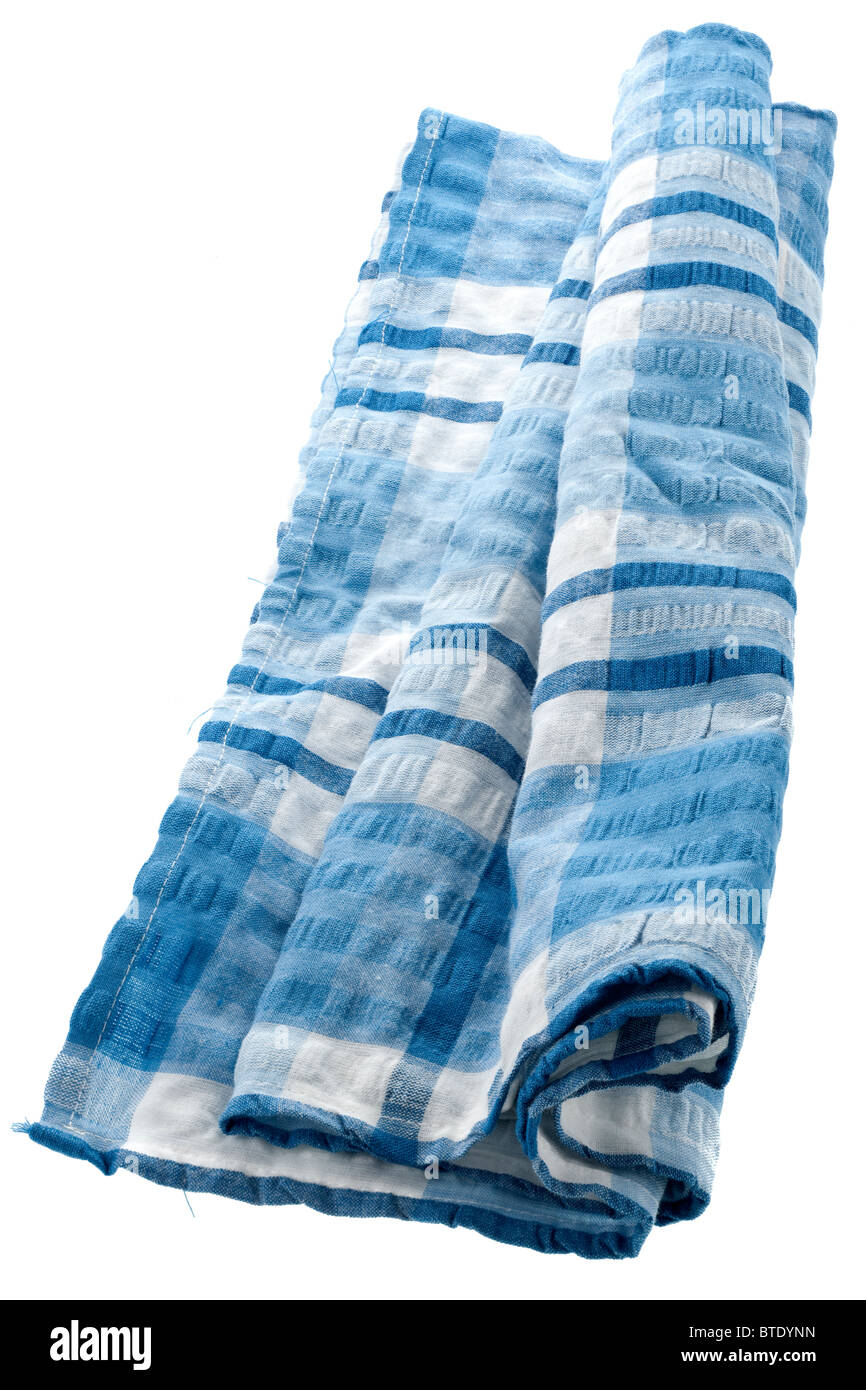 Rolled blue seersucker tablecloth - Stock Image