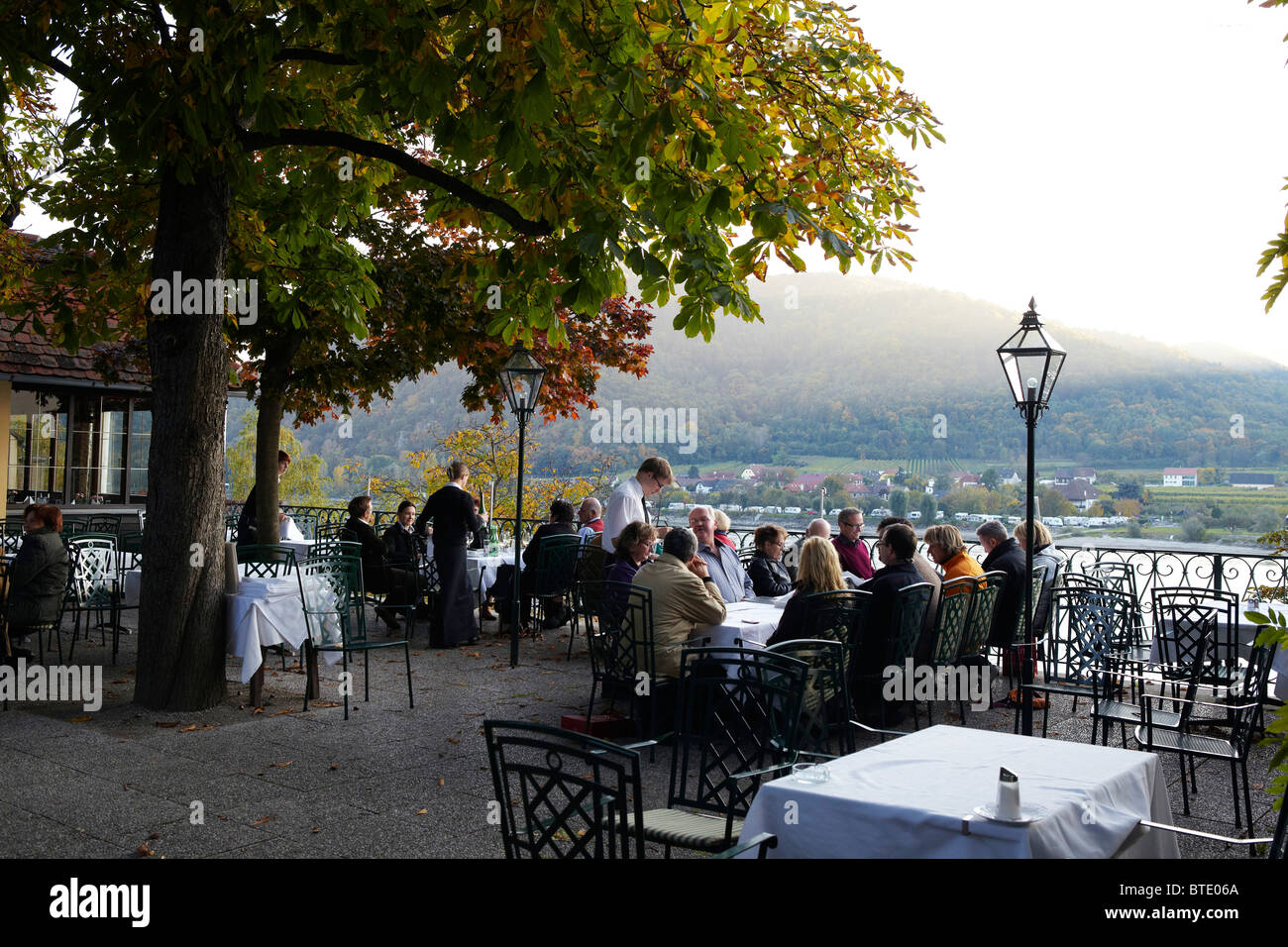 restaurant on terrace overlooking Danube river - Stock Image