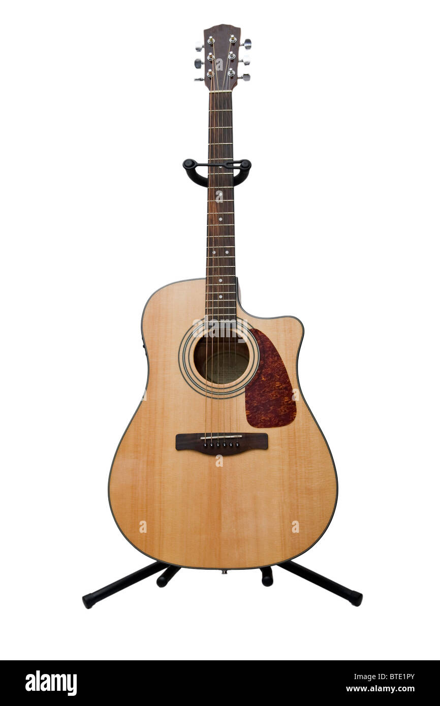 Acoustic guitar on white background - Stock Image
