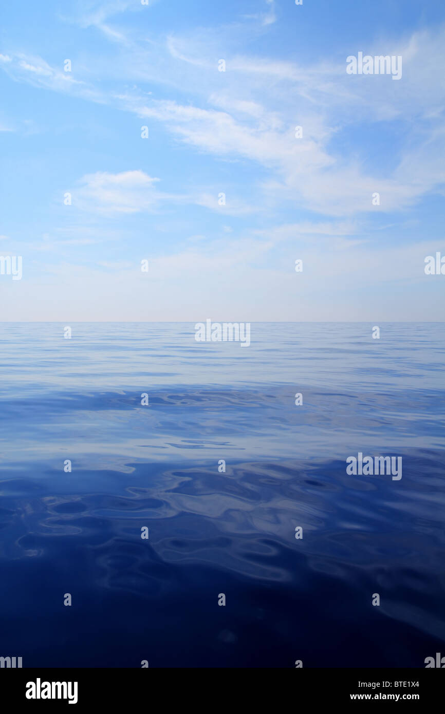 Calm sea blue water ocean sky horizon scenics in Mediterranean - Stock Image