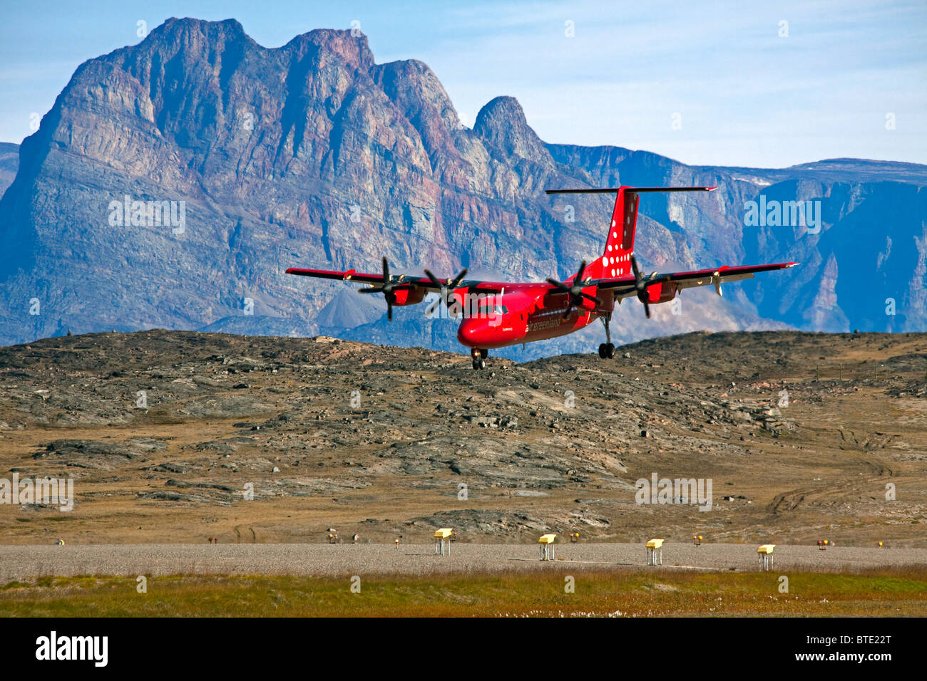 Airplane de Havilland DHC-7 / Dash 7 from Air Greenland landing at the Qaarsut Airport, Greenland - Stock Image