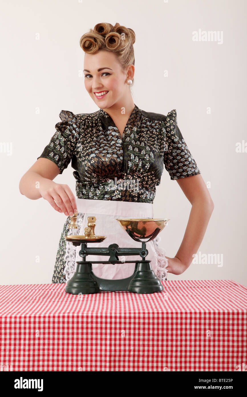 Woman with weight scales - Stock Image