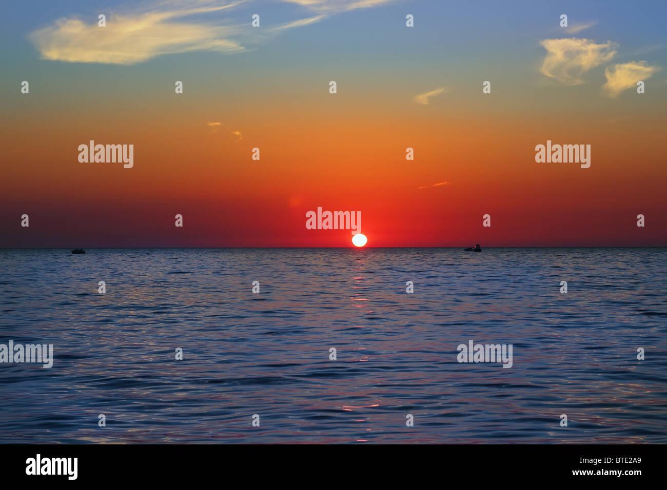 blue golden sunrise seascape sea ocean red golden colorful - Stock Image