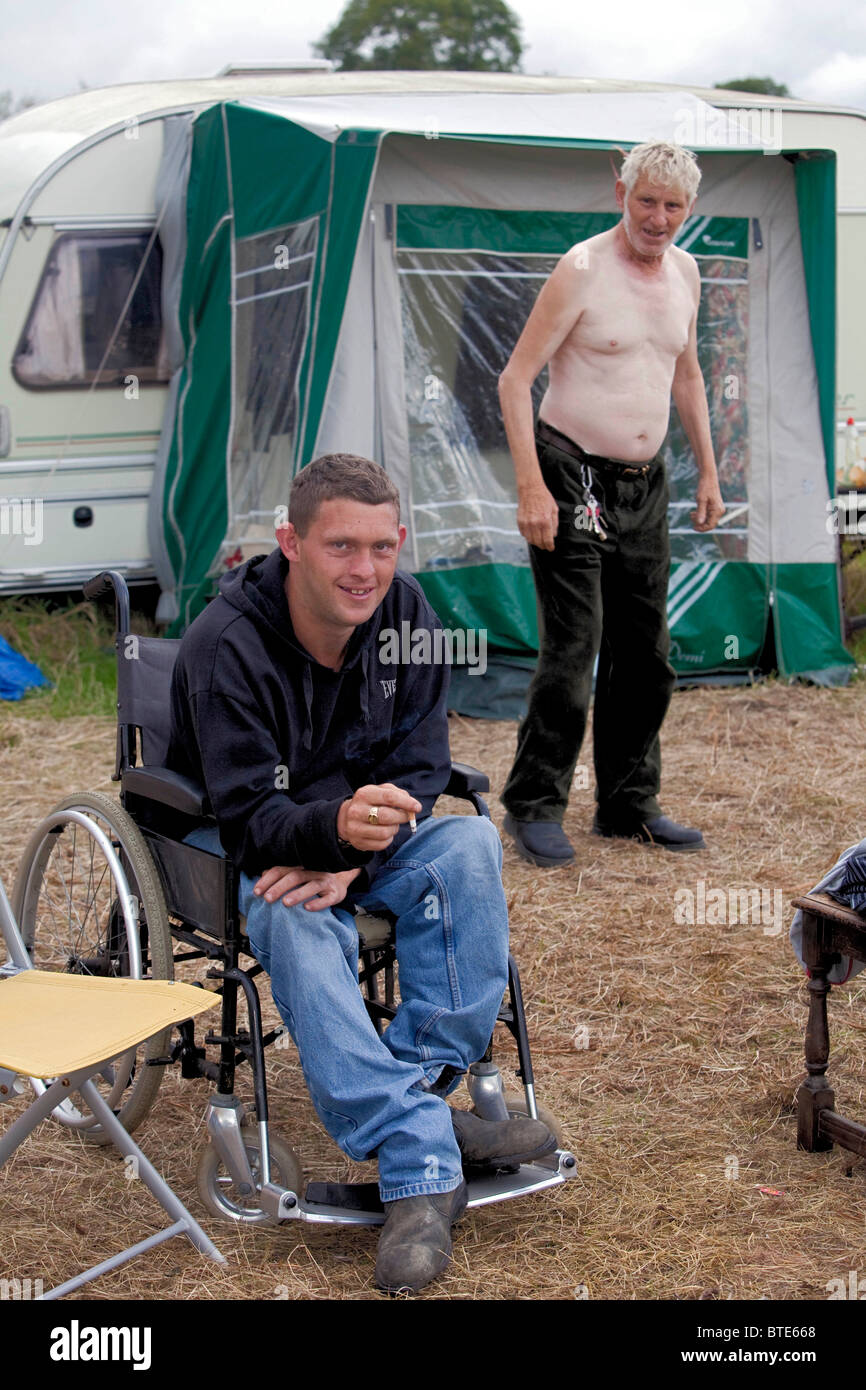 Mike Hughes and his disabled son Shane, the family now live in a house, coming to Priddy Sheep Fair is a holiday. - Stock Image