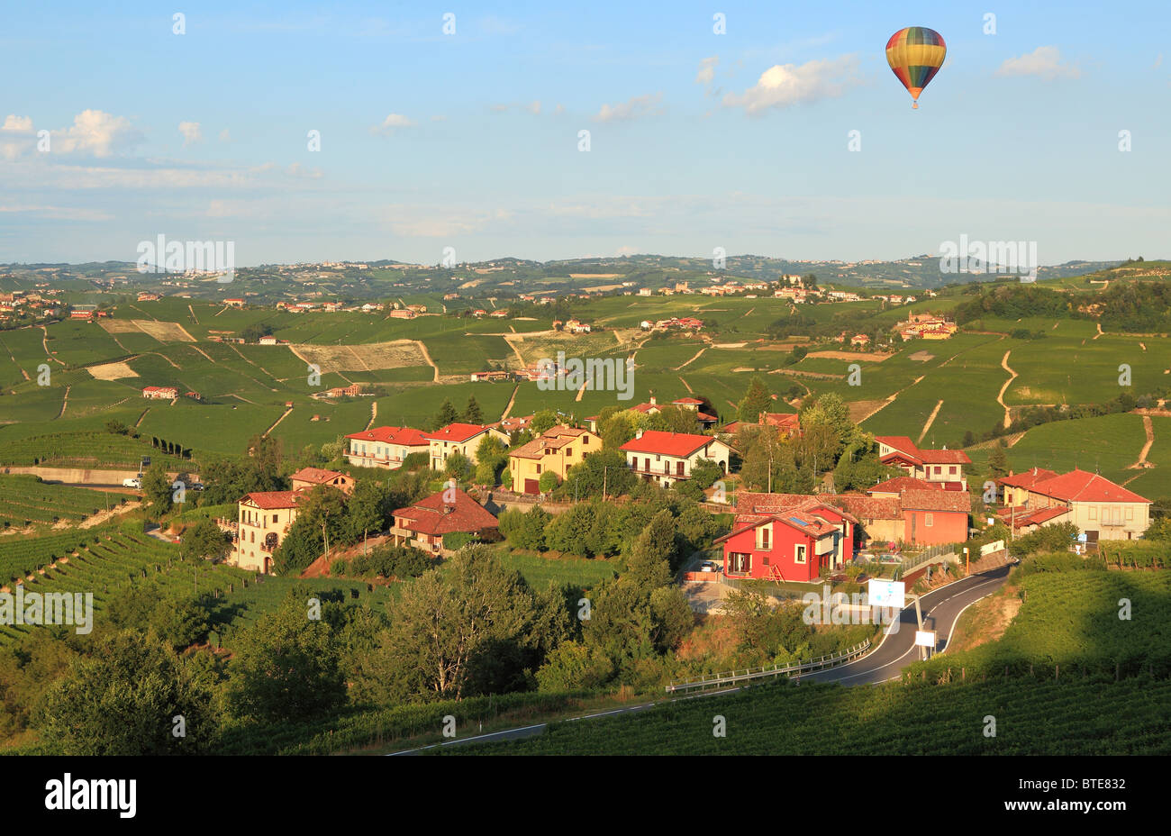 Air balloon flying over vineyards of Piedmont in northern Italy. - Stock Image