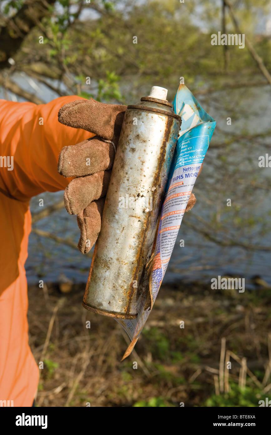 Holding rusty spray bottle - Stock Image