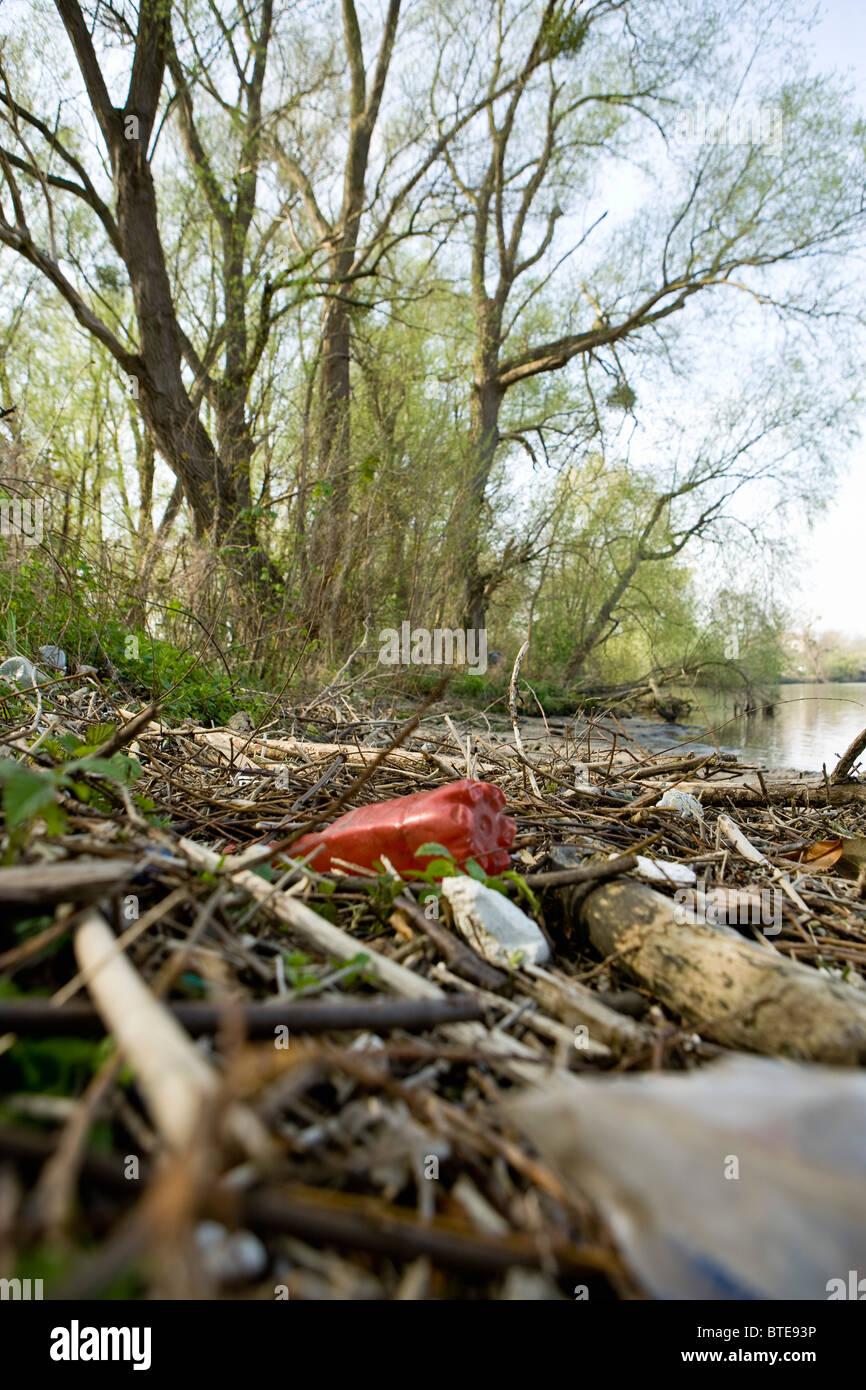 Trash by lake - Stock Image
