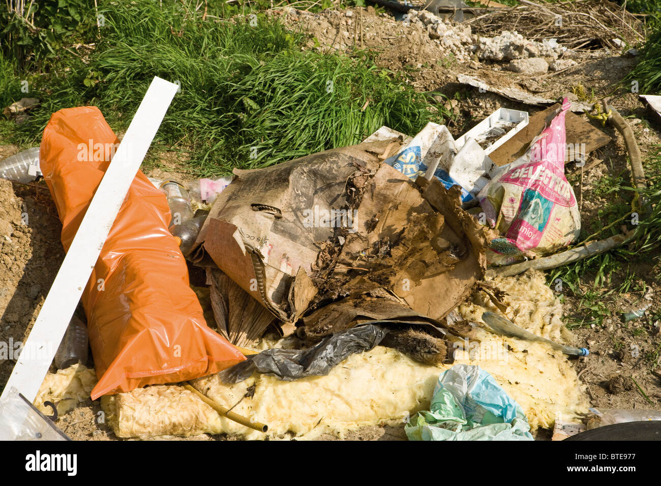 Garbage piled up outdoors - Stock Image