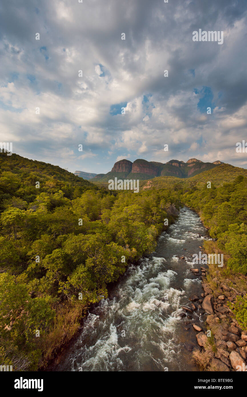 A fast-flowing stream with the three rondawels in the distance - Stock Image